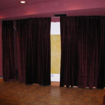 Side wall showing Sound Absorbing Acoustic Panels behind Drapery